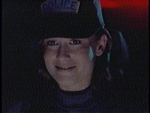 In the future, people are too dumb to know you're a cop unless you have a goofy hat with POLICE written in huge letters on the front.